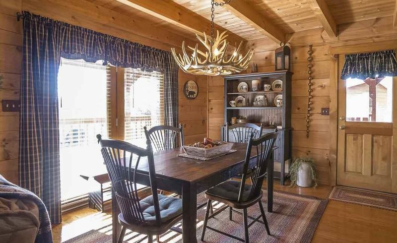 Antler chandelier in a log cabin dining area