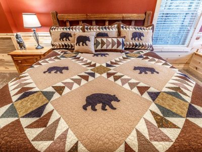 Choosing cabin bedding like this bear quilt sets a room theme