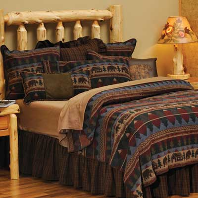 Cabin Bear coverlet on a log bed