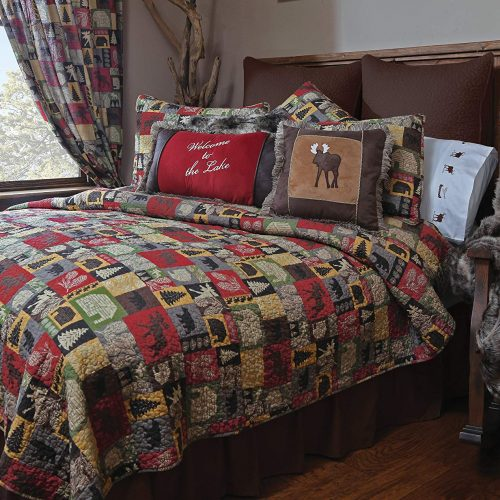 Colorful patchwork Cabin in the Woods quilt on a bed