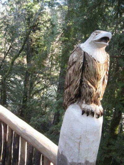 Carved eagle on post of log home railing