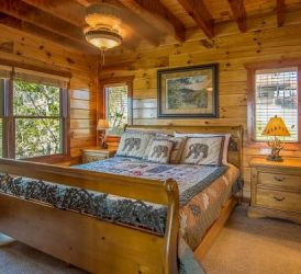 ceiling light in log cabin bedroom