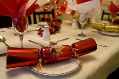 Christmas dinnerware on a festive table with red decorations