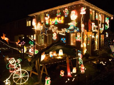 House with too many Christmas lawn decorations