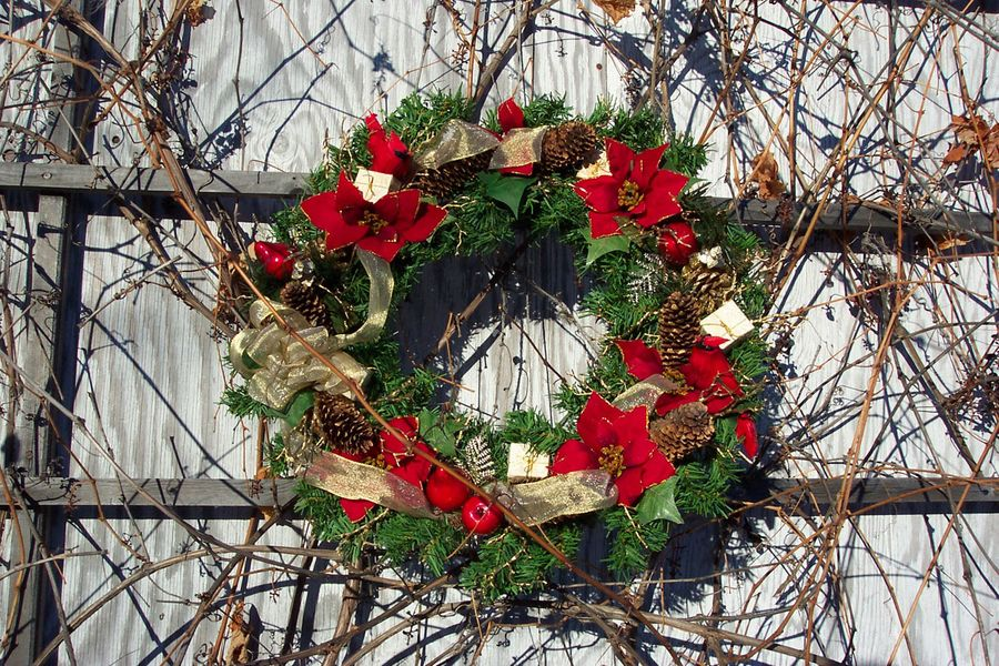 Christmas wreath with twig background