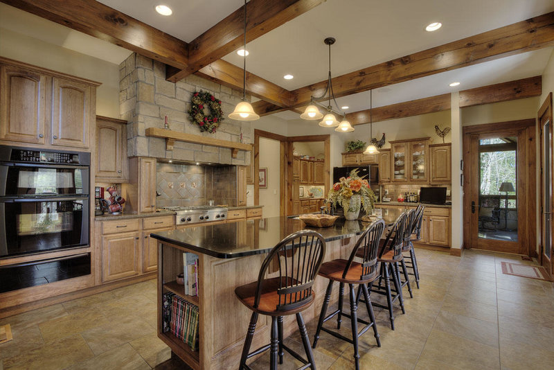 Country kitchen decor in a timber frame house kitchen