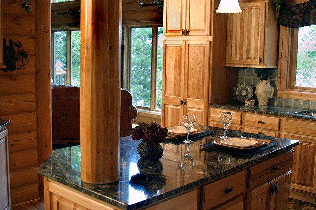 Kitchen island with black granite top and moose sitting on counter