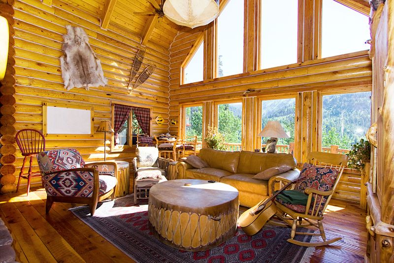 Sunny interior of log home with rustic decorations