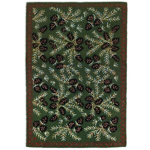 pinecones and green boughs on a dark green rug