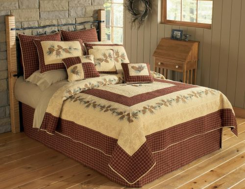 Pretty Pine River quilt on a bed