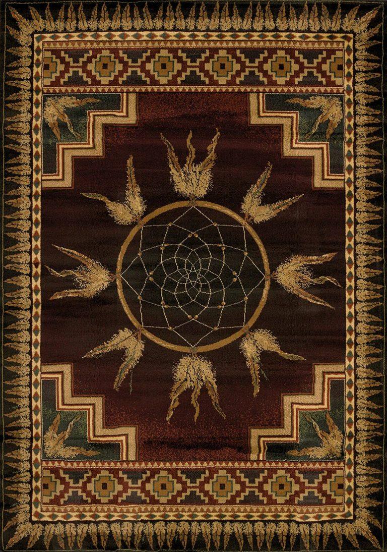 native american dream catcher on burgundy rug