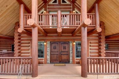log home entryway with railings