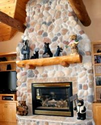 Fireplace mantle decorated with bears