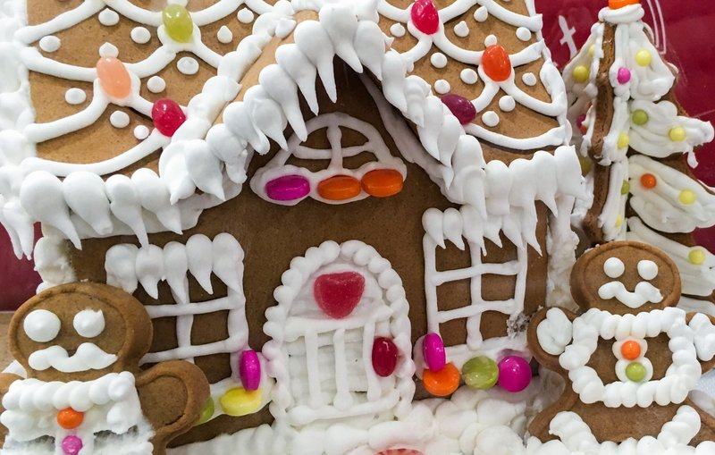 Gingerbread house with colored candies and white icing