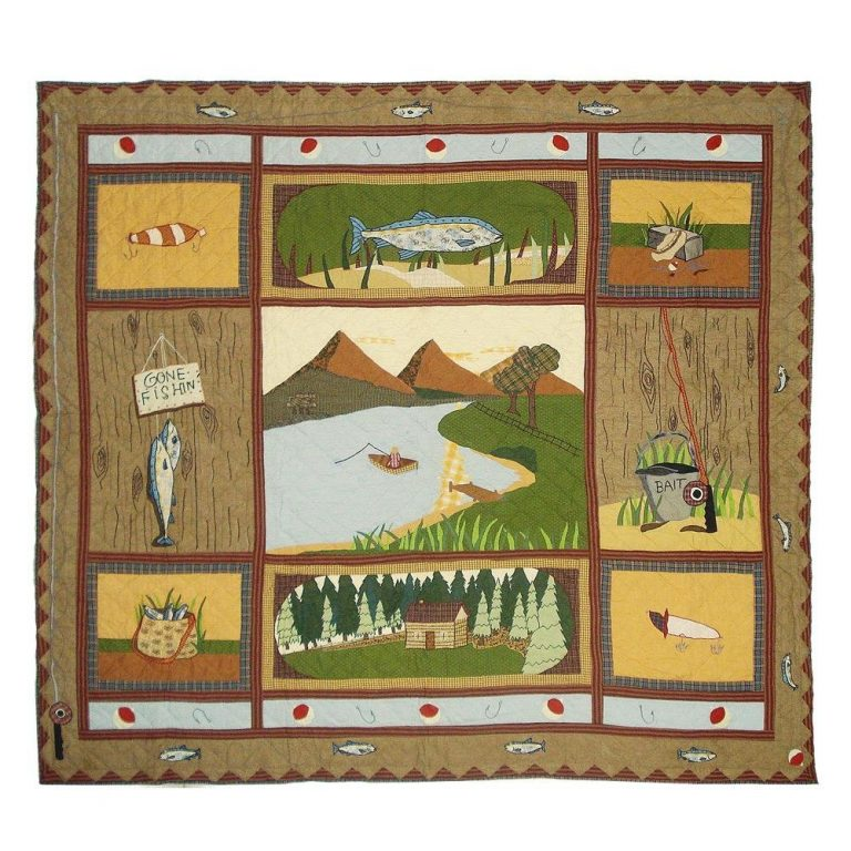 Patch Magic Gone Fishing quilt on a bed