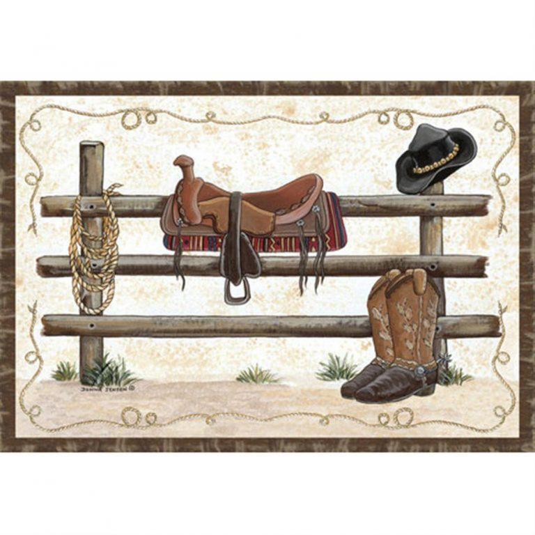 rug with saddle, lasso, cowboy hat, on fence
