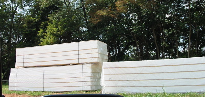 Structural insulated panels in piles on skids
