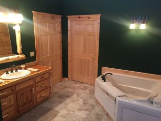 large bath tub in log home