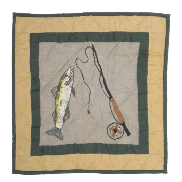 Patch Lodge Fever quilt pillow with fish and fishing rod