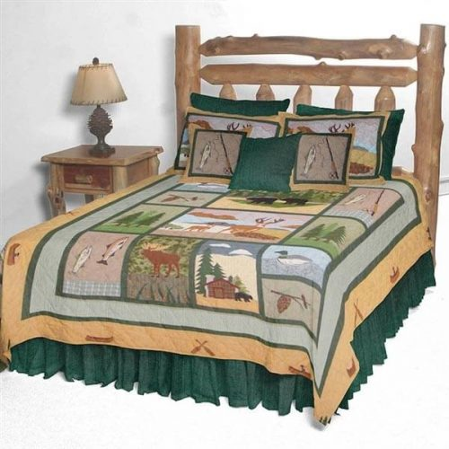 Patch Magic Lodge Fever quilt on a bed