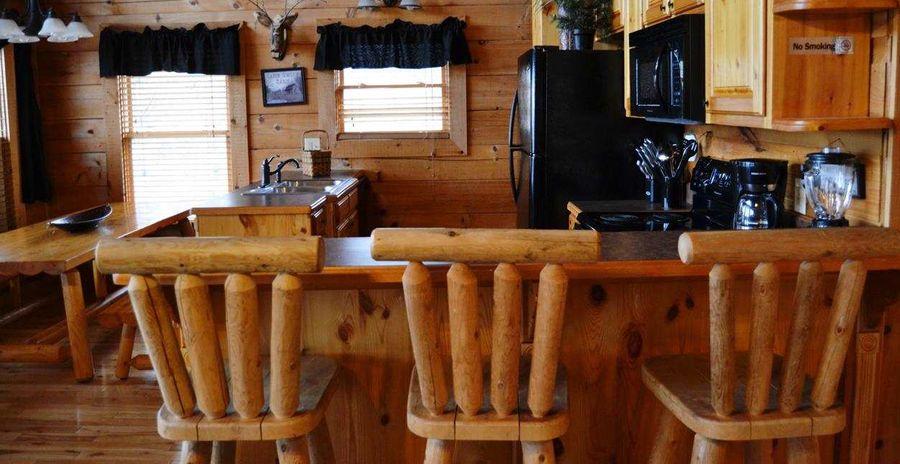 Log bar stools in log cabin