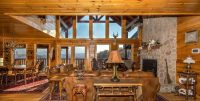 Red log cabin rugs in pretty log home great room