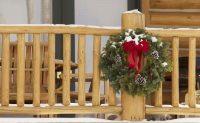 Christmas wreath on log porch post