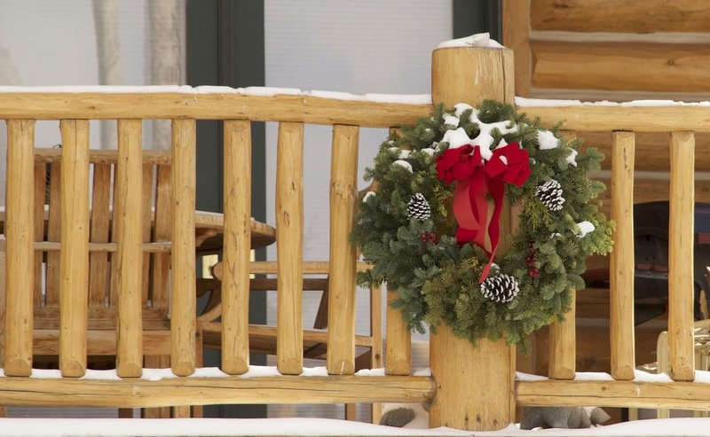 Christmas wreath on log porch post