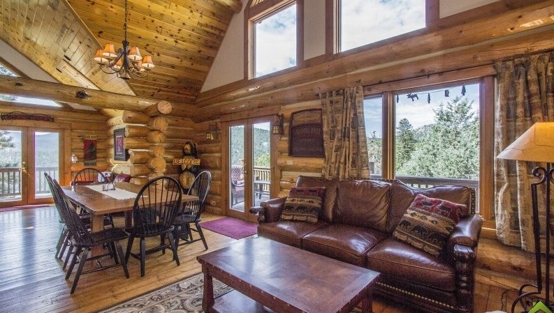 Great room and dining area of beautiful log cabin