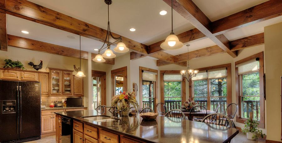 Log home lighting in kitchen and dining area