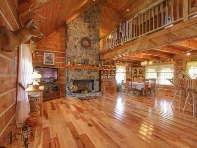 Log home interior with no definition of spaces