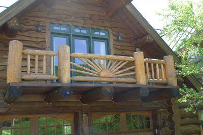 Log railing with design