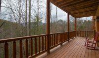 Log railing and porch on a log home