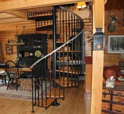 Wrought iron circular staircase in log home