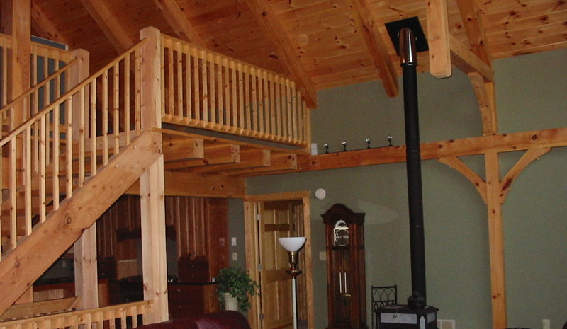 Great room in home with post and beam construction