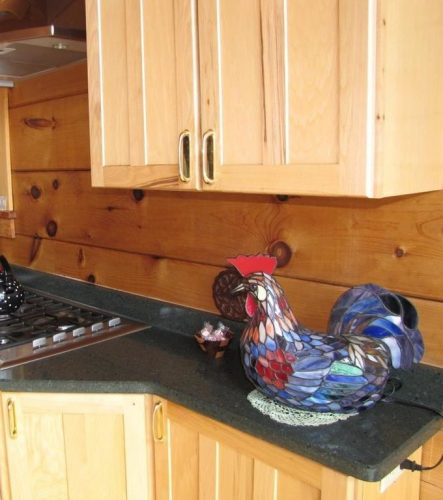 Roosters are a popular theme in log home kitchens