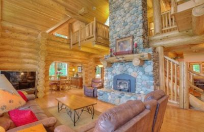 Interior of log home with round logs