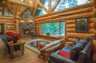 Rustic log decor in a beautiful log cabin common area.