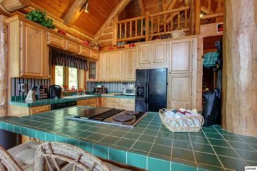 maple cabinets in log home