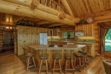 Cozy kitchen island in log home