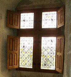 Rustic shutter in an old church