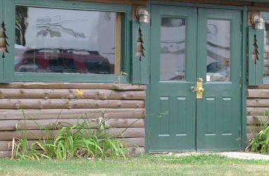 Pine tree shutters on log building