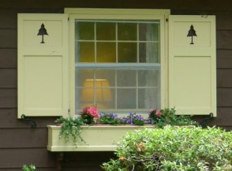 Yellow shutters with pine tree cut outs