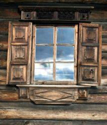 Rustic shutters on log cabin