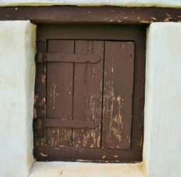 Rustic shutters with wrought iron hinges