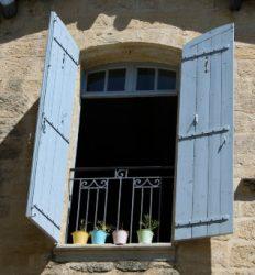 Blue rustic shutters that lock inside