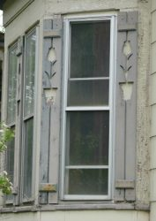 Rustic shutters with tulip cutouts