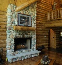 Stone fireplace made with river rocks