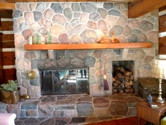 Stone fireplace with built-in wood rack
