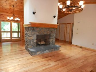 Stone fireplace in center of a room